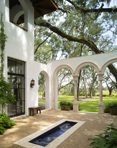 Courtyard Design with Pool and Arches